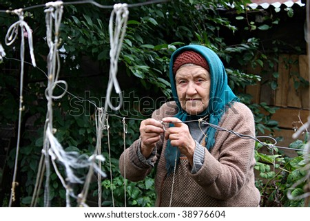 Old woman doing some work - stock photo