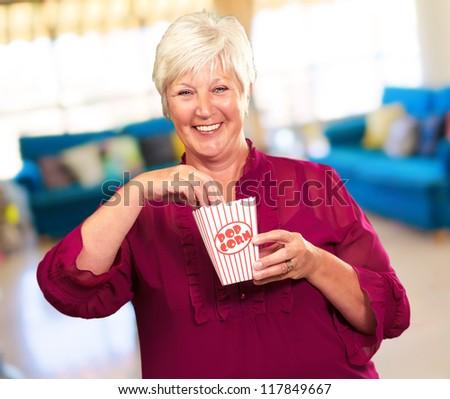 Old Woman Eat Popcorn, Indoor - stock photo