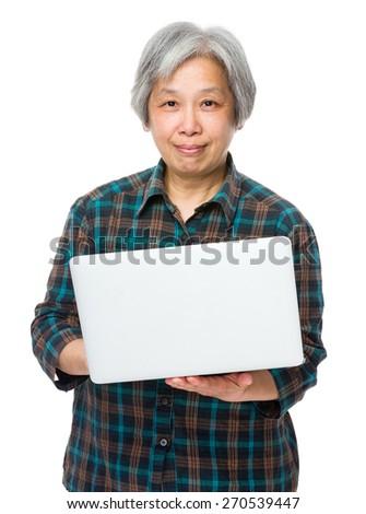 Old woman enjoys computer - stock photo