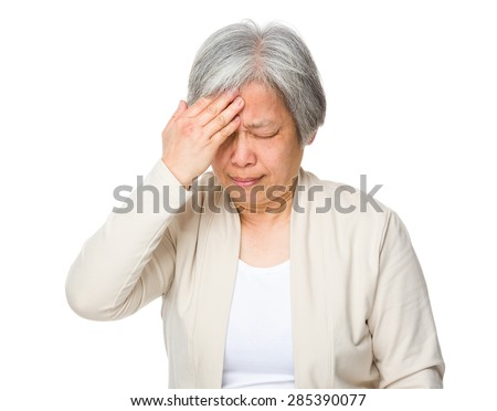 Old woman feeling headache - stock photo