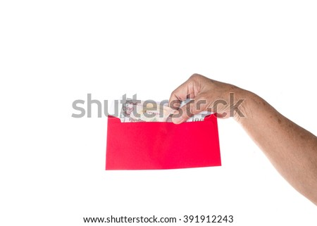 Old woman hand holding Thai money in red envelope on white. - stock photo