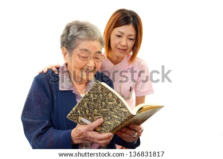 Old woman reading her book - stock photo