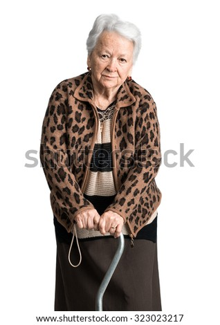 Old woman standing with a cane on a white background - stock photo