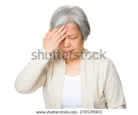 Old woman suffer from headache - stock photo