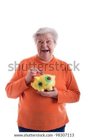 Old woman with a savings box - stock photo