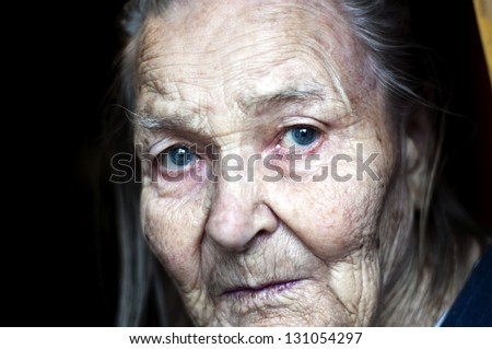 old woman with blue eyes - stock photo