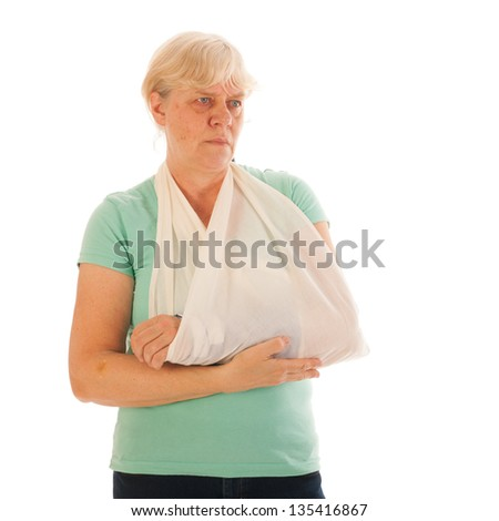 Old woman with broken wrist in blue gypsum isolated over white background - stock photo