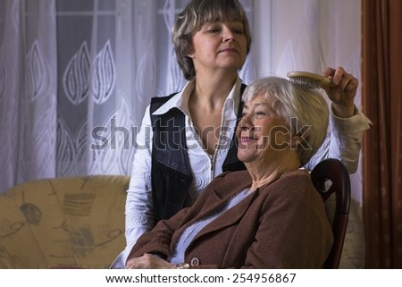 Old woman with daughter - stock photo