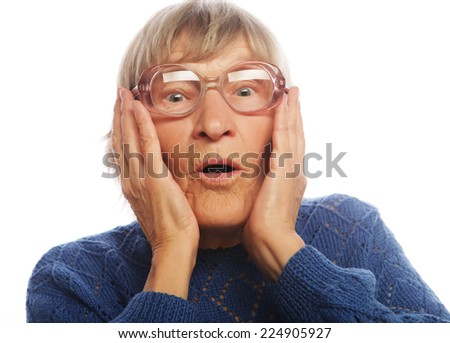 Old Woman with surprised expression on her face - stock photo