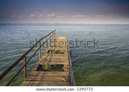 old wood arbor in the lake - stock photo