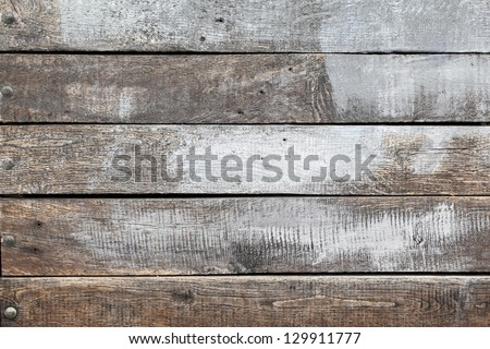 Old wood background with white painting - stock photo