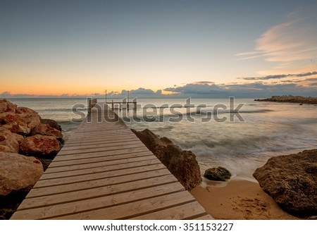 old wood bridge pier with nobody against beautiful morning sky use for natural background ,backdrop and multipurpose sea scene - stock photo