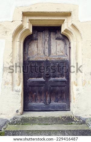 old wood door with metal knob  in Prejmer fortified church, Brasov county, Romania - stock photo
