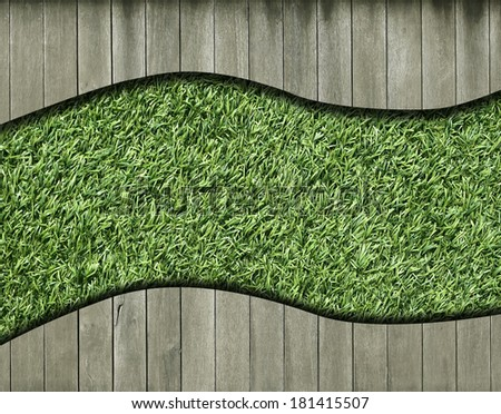 Old  wood plank and green grass background - stock photo