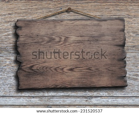 old wood plank or plate hanging on timber plank wall background - stock photo