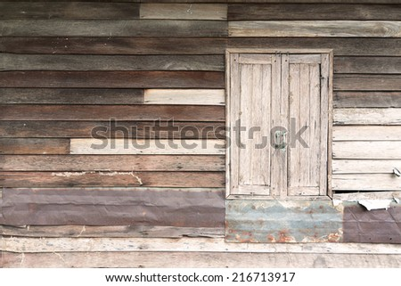 Old wood wall with window for background.  - stock photo