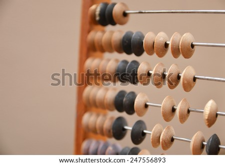 Old wooden abacus on gray background - stock photo