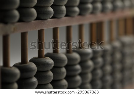 Old wooden abacus with a calculated, shot with very shallow depth of field , Macro photography - stock photo