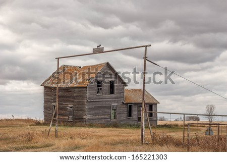 Old Wooden Abandoned Farm House - stock photo