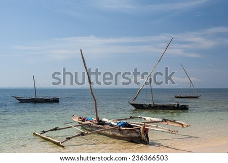 Old wooden arabian dhow - fishing boats -  in the ocean. Kenya, Africa  - stock photo