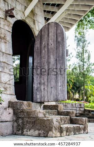 Old wooden arch door. Open door, made of wooden planks background - stock photo