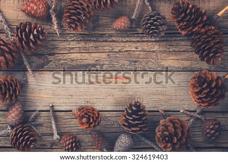 Old wooden background with pine cones. Christmas decoration.Toned image. Vintage style. Copy space. selective focus.  - stock photo