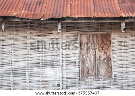 Old wooden bamboo wall - stock photo