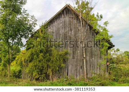Old wooden bar with red roof and old bricks  - stock photo