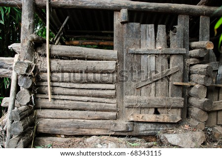 old wooden barn door in the forest in china - stock photo