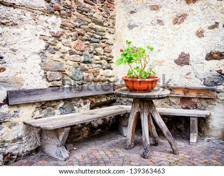 old wooden bench at a backyard - stock photo