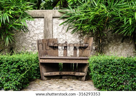 Old Wooden Bench in the garden - stock photo