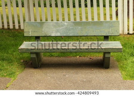Old wooden bench in the park - stock photo