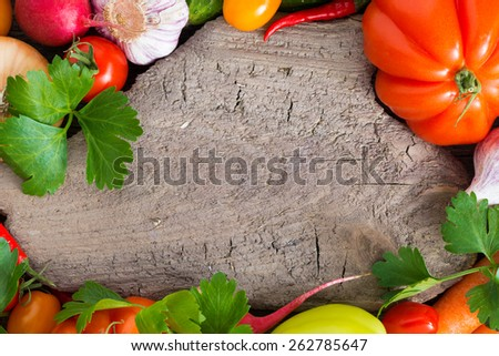 old wooden board for text, spices and fresh vegetables, top view, close-up, horizontal - stock photo