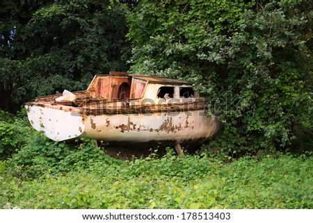 old wooden boat stranded in the bush.  - stock photo