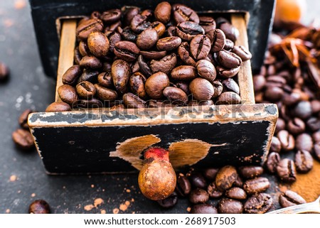 Old wooden box with coffee beans inside - stock photo