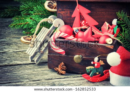 Old wooden box with vintage Christmas decorations - stock photo