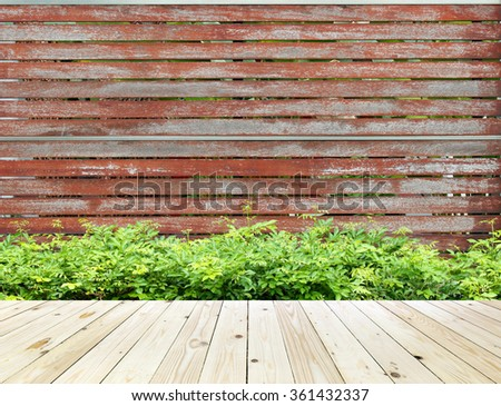 Old wooden brown fence wall and wood floor - stock photo