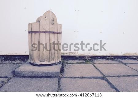 old wooden bucket on brick floor  - stock photo
