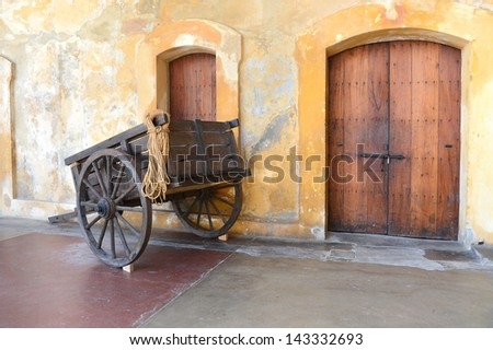 Old wooden cart in Old San Juan Puerto Rico - Castillo San Cristobal - stock photo