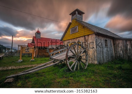 Old wooden chapel at night, Remote village Villa O'Higgins, Carretera Austral road, Patagonia, Chile - stock photo