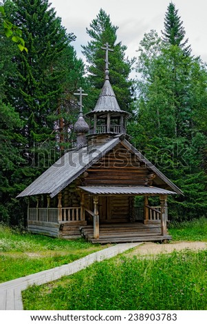 Old wooden chapel in the reserve Malye Korely - stock photo