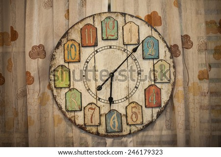 Old wooden clock - stock photo
