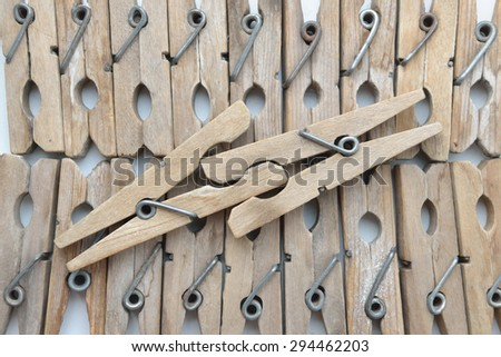 old wooden clothespins - stock photo