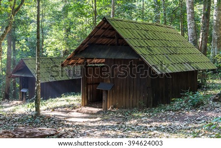 Old wooden cottage which abandoned in the forest of Thailand. - stock photo