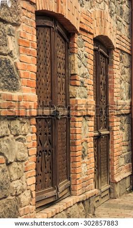 Old wooden curved doors in Borjomi, Georgia - stock photo