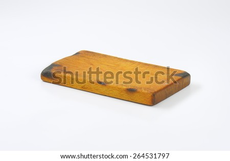Old wooden cutting board - stock photo