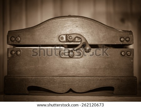 Old wooden decorative casket. Vintage background. Sepia photo. - stock photo
