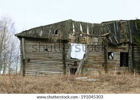 old wooden destroyed house - stock photo