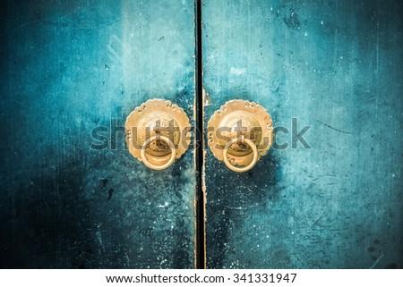 old wooden door and antique oriental knocker - stock photo