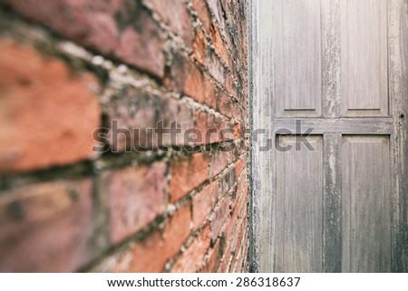 "Old wooden door and"" blur"" brick wall - stock photo"